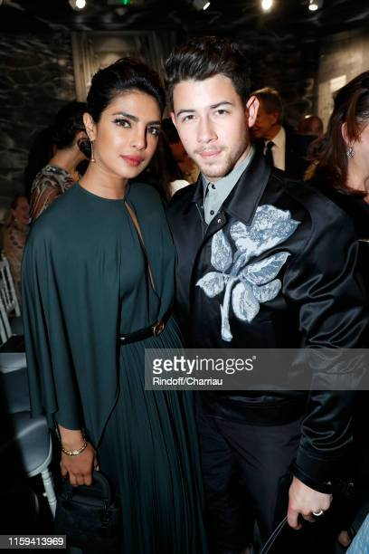 Priyanka Chopra and Nick Jonas attend the Christian Dior Haute Couture Fall/Winter 2019 2020 show as part of Paris Fashion Week on July 01, 2019 in...