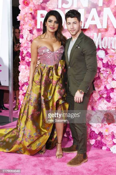 "Priyanka Chopra and Nick Jonas attend the premiere of ""Isn't It Romantic"" at The Theatre at Ace Hotel on February 11, 2019 in Los Angeles, California."