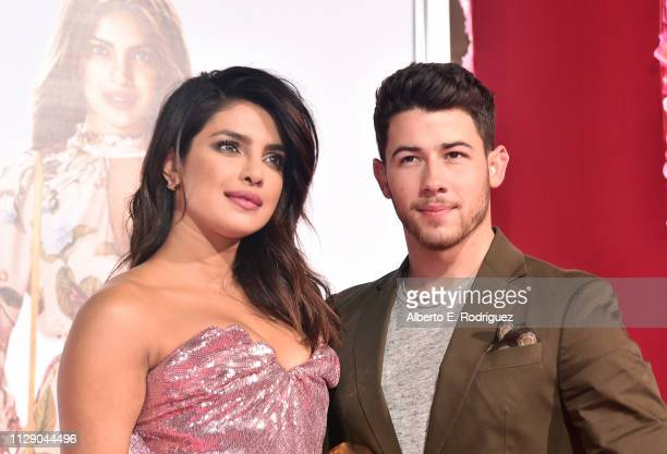 "Priyanka Chopra and Nick Jonas attend the premiere of Warner Bros. Pictures' ""Isn't It Romantic"" at The Theatre at Ace Hotel on February 11, 2019 in..."