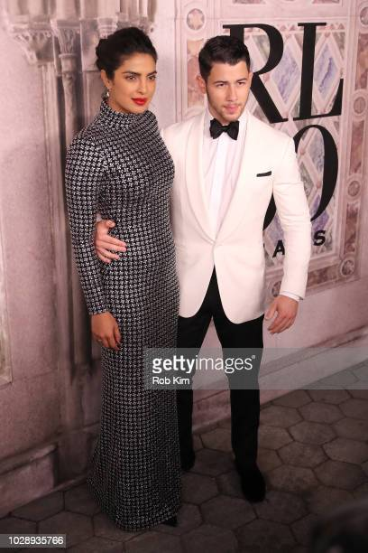 Priyanka Chopra and Nick Jonas attend the Ralph Lauren fashion show during New York Fashion Week at Bethesda Terrace on September 7 2018 in New York...