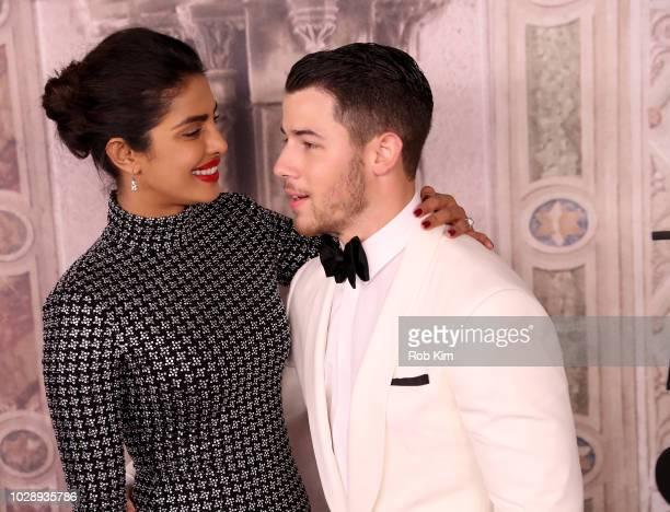 Priyanka Chopra and Nick Jonas attend the Ralph Lauren fashion show during New York Fashion Week at Bethesda Terrace on September 7 2018 in New York...