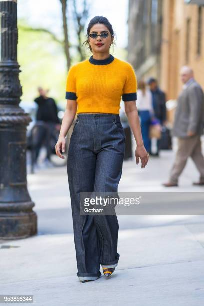 Priyanka Chopra is seen wearing a Ganni top Frame Denim jeans and Fendi shoes with Vogue X Gigi eyewear in the Upper West Side on May 2 2018 in New...