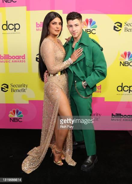 Priyanka Chopra Jonas and Nick Jonas pose backstage for the 2021 Billboard Music Awards, broadcast on May 23, 2021 at Microsoft Theater in Los...