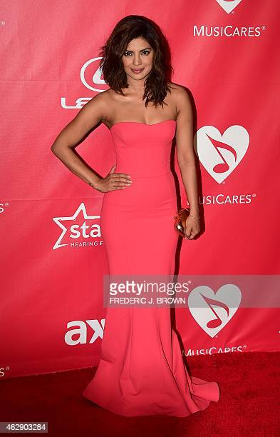 Priyanka Chopra poses on arrival for the 2015 MusiCares Person of the Year annual benefit gala dinner and concert in Los Angeles California on...