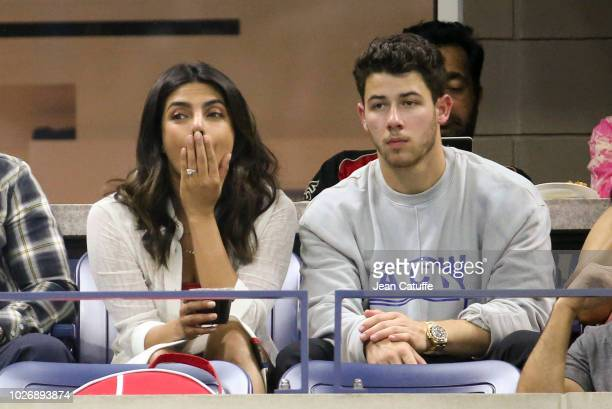 Priyanka Chopra, wearing her engagement ring, and fiance Nick Jonas attend Serena Williams' quarter-final victory on day 9 of the 2018 tennis US Open...