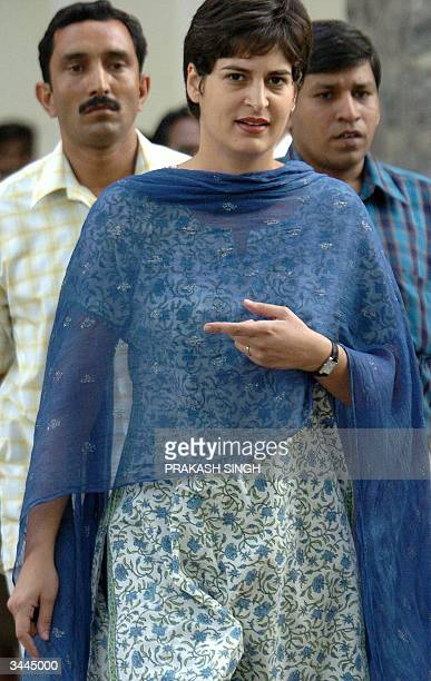 Priyanka Gandhi daughter of the Leader of India's Congress Party Sonia Gandhi is surrounded by security officials as she leaves the Election...