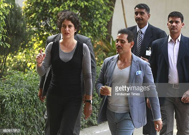 Priyanka Gandhi Vadra and Robert Vadra coming out after casting their vote at a polling station during the Delhi Assembly Elections 2015, at...