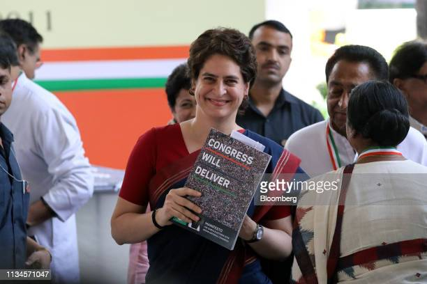 Priyanka Gandhi Vadra general secretary of the Congress party holds up a copy of the Congress manifesto at an event marking the document's launch at...