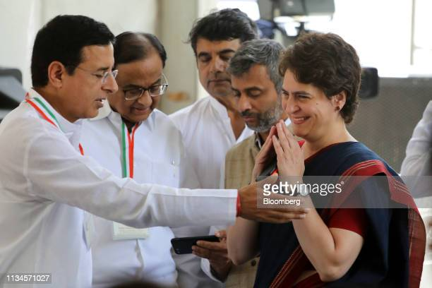 Priyanka Gandhi Vadra general secretary of the Congress party right arrives for an event marking the release of the Congress manifesto at the party's...