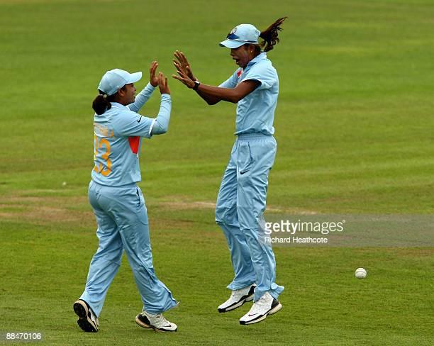 Priyanka Roy of India celebrates catching Sajida Shah of Pakistan with Indian captain Jhulan Goswami during the ICC Women's Twenty20 World Cup match...