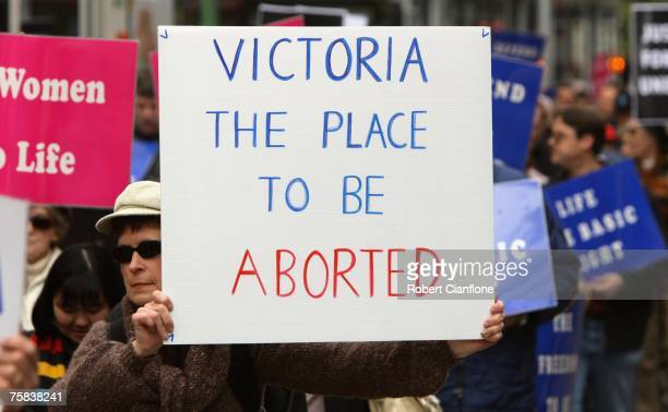 Pro abortion protesters hold up signs during a protest on the steps of Parliment House on July 28 2007 in Melbourne Australia The Labour government...