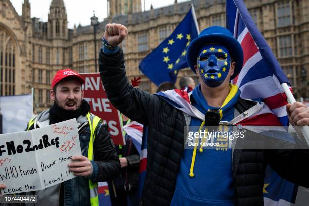 Pro and Anti Brexit protesters clash outside the Houses of Parliament on December 19 2018 in London England The European Commission has announced...