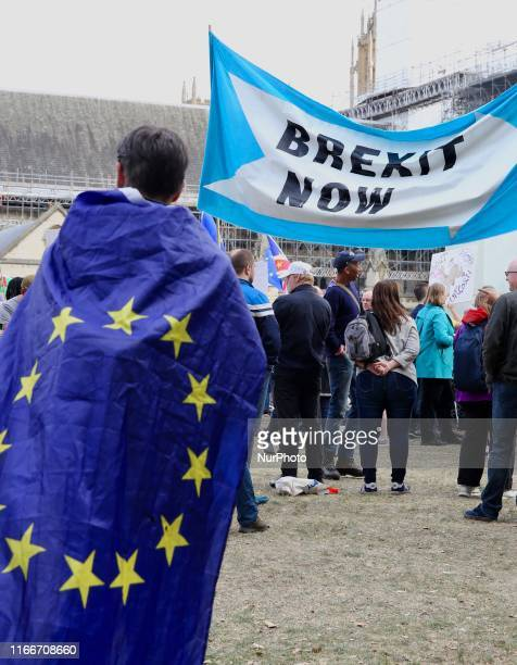Pro and AntiBrexit demonstrators secured by a number of police officers protest at Parlament Square London England on Saturday September 7 2019 The...