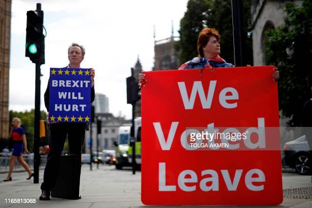 Pro and antiBrexit protesters stand with placards outside the Houses of Parliament in central London on September 3 2019 The fate of Brexit hung in...