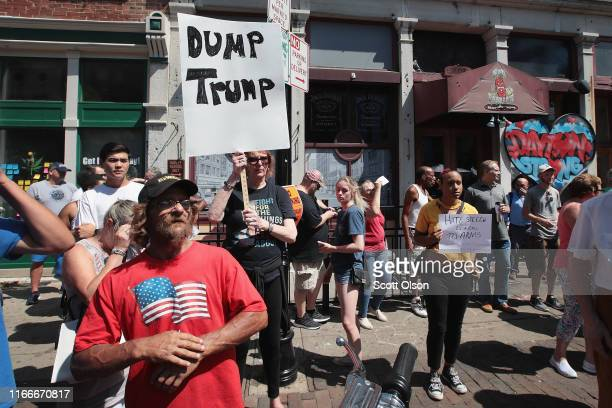 Pro and antiTrump demonstrators protest in the Oregon District where a mass shooting early Sunday morning left nine dead and 27 wounded on August 07...