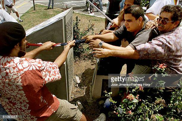 Pro And AntiUs Navy Demonstrators Grapple For Control Of An American Flag July 28 2001 In Vieques Puerto Rico Demonstrators Attempted To Raise The...