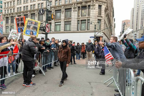 Pro and contra President Trump agenda argue across police line during antiUS rally by Take Action NYC Leftists organizations on Herald Square