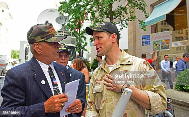 Pro anti activists Trump supporter Al Baldasaro chats with Trump opponent Terry O'Brien in front of Trump Tower Pro and anti Trump activists gathered...