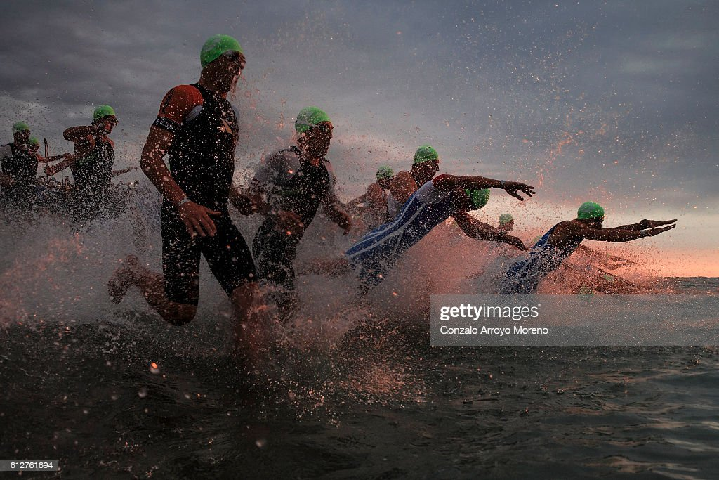 Pro athletes start the swimming course of the Ironman Barcelona on October 2, 2016 in Calella, Spain.