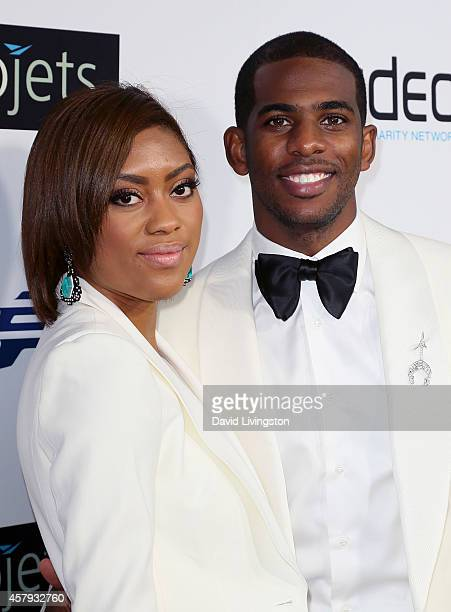 Pro basketball player Chris Paul and wife Jada Crawley attend the CP3 Foundation Celebrity Server Dinner at Mastro's Steakhouse on October 26 2014 in...