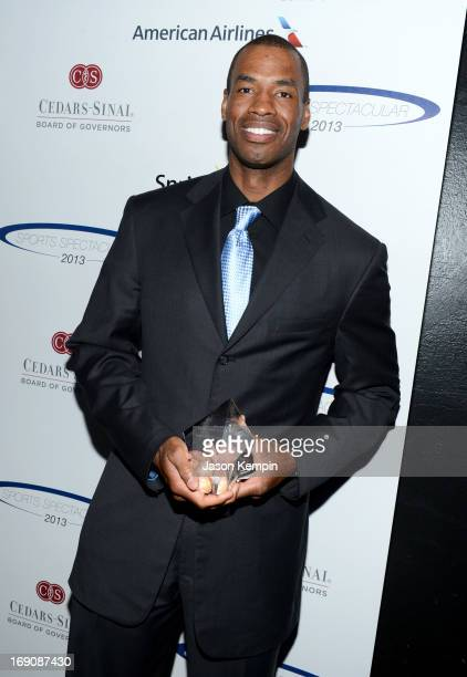 Pro basketball player Jason Collins poses with the Inspirational Athlete of the Year Award at the 28th Anniversary Sports Spectacular Gala at the...