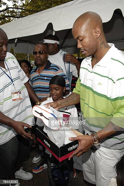Pro Basketball Player Stephon Marbury with Jahsiyh giving away his Starbury Sneakers at The New York Call and Youth Xplosion Starbury Giveback Day on...