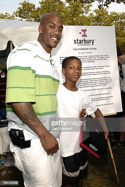 Pro Basketball Player Stephon Marbury with Roger Mull giving away his Starbury Sneakers at The New York Call and Youth Xplosion Starbury Giveback Day...