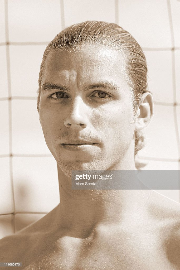 b628a9148bc Pro Beach volleyball player Stafford Slick poses for photos during ...