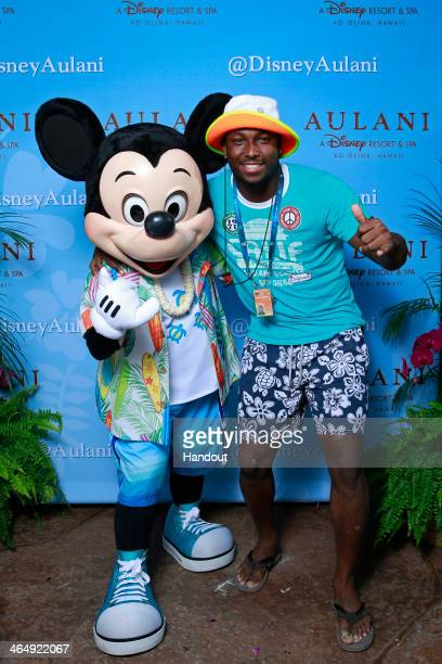 Pro Bowl running back LeSean McCoy of the Philadelphia Eagles gets in the Aloha spirit with Mickey Mouse during a NFLPA Pro Bowl players reception at...