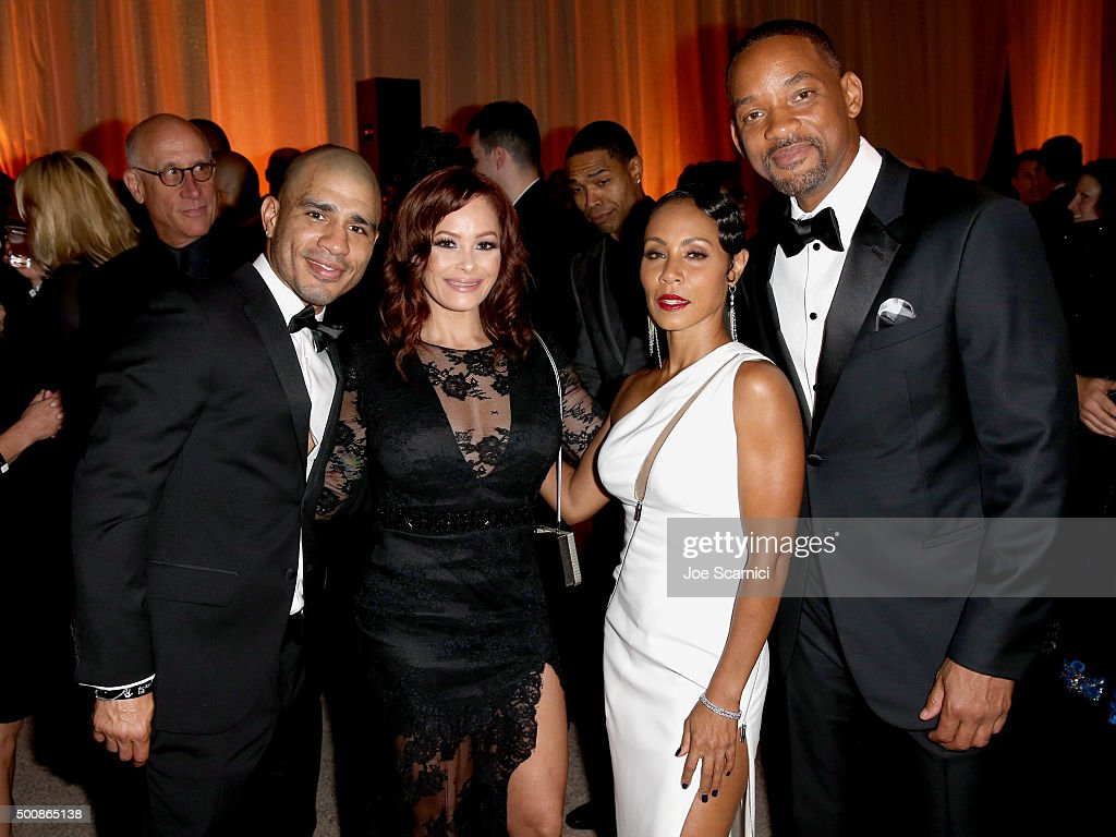 Pro boxer Miguel Cotto, Melissa Guzman and actors Jada Pinkett Smith and Will Smith attend The Diamond Ball II with D'USSE and Armand de Brignac at The Barker Hanger on December 10, 2015 in Santa Monica, California.