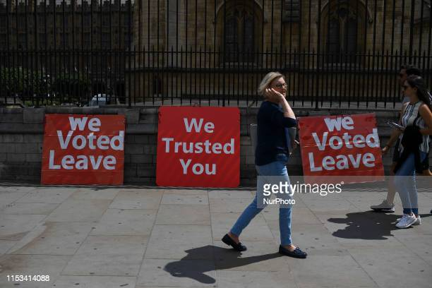 Pro Brexit demonstrators display placards supporting Boris Johnson in the race to Conservative Party leadership London on July 3 2019