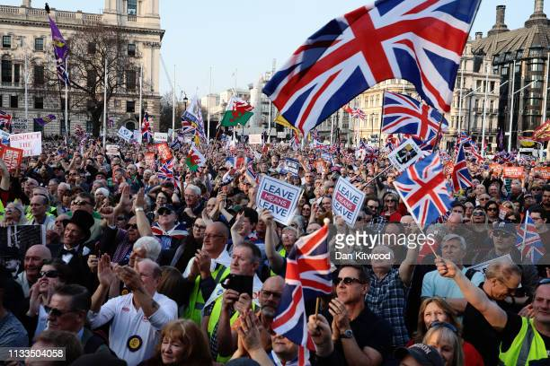 Pro Brexit demonstrators gather for a speech by Nigel Farage in central London on March 29 2019 in London England Today proBrexit supporters...