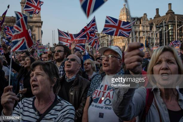 Pro Brexit demonstrators gather in Parliament Square to listen to Nigel Farage speak on March 29 2019 in London England Today proBrexit supporters...