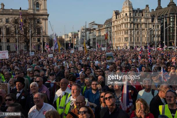 Pro Brexit demonstrators gather in Parliament Square to listen to Nigel Farage speak on March 29, 2019 in London, England. Today pro-Brexit...