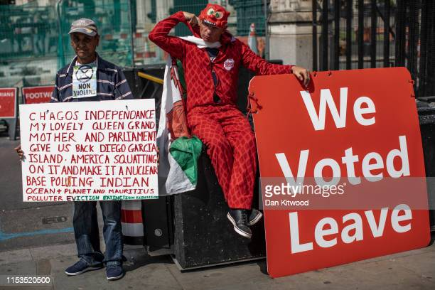 Pro Brexit protesters continue their presence outside the Houses of Parliament on July 3 2019 in London England Boris Johnson and Jeremy Hunt are...