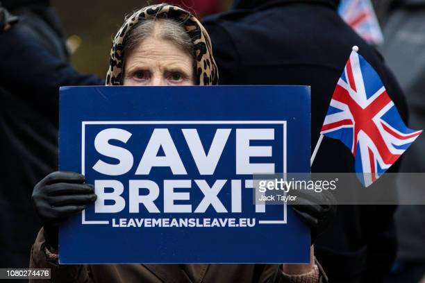Pro Brexit protesters demonstrate with placards outside the Houses of Parliament Westminster on December 10 2018 in London England The Government are...