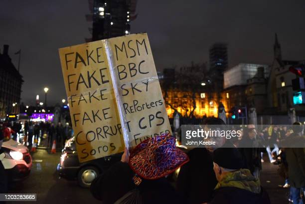 A pro Brexit supporter holds a placard stating Fake MSM BBC Sky Reporters Corrupt CPS during the Leave Means Leave Brexit day celebration party...