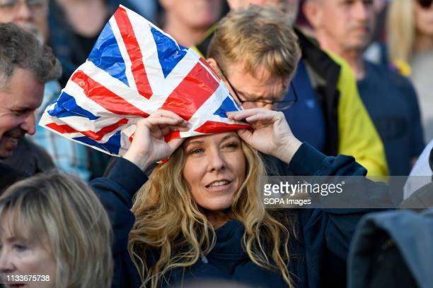 Pro Brexit supporter seen wearing a plastic bag as a hat with the United Kingdom flag stamped on it during the Leave means leave rally in London A...