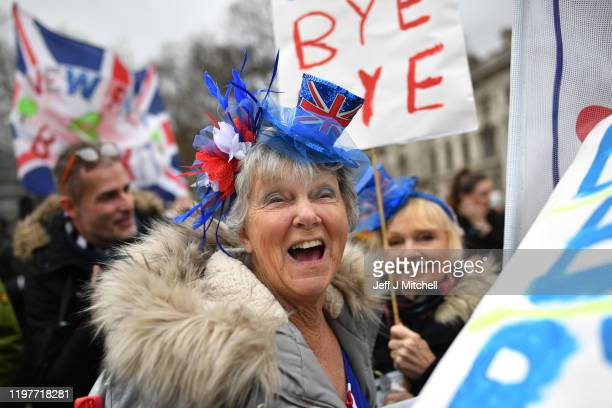 Pro Brexit supporter wears a novelty Union Jack top hat outside the Houses of Parliament as people prepare for Brexit on January 31 2020 in London...
