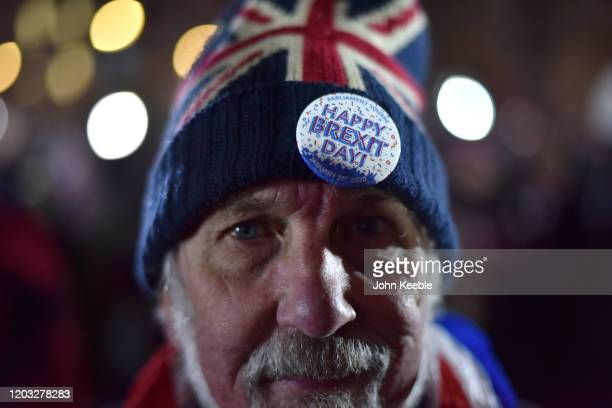 A pro Brexit supporter wears a Union Jack woolly hat and a Happy Brexit Day badge during the Leave Means Leave Brexit day celebration party outside...