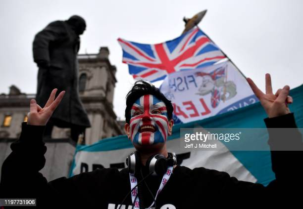 Pro Brexit supporter with a painted Union Jack face at Parliament Square as people prepare for Brexit on January 31, 2020 in London, United Kingdom....