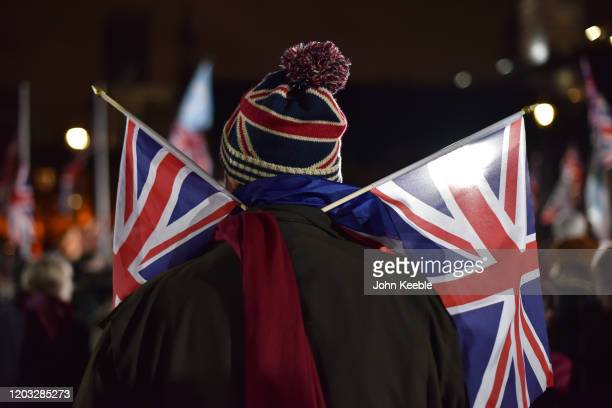 A pro Brexit supporter with Union Jack woolly hat and flags during the Leave Means Leave Brexit day celebration party outside the Houses of...