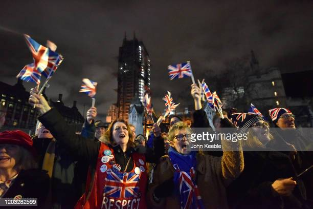 Pro Brexit supporters celebrate leaving the EU at the Leave Means Leave Brexit day celebration party outside the Houses of Parliament at Parliament...