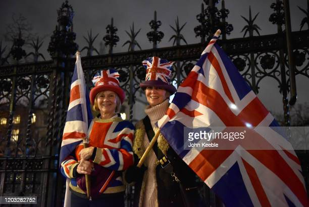 Pro Brexit supporters wear Union Jack hats and hold flags during the Leave Means Leave Brexit day celebration party outside the Houses of Parliament...