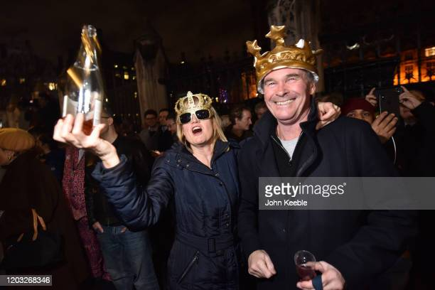 Pro Brexit supporters wearing crowns celebrate leaving the EU at the Brexit day celebration party outside the Houses of Parliament at Parliament...