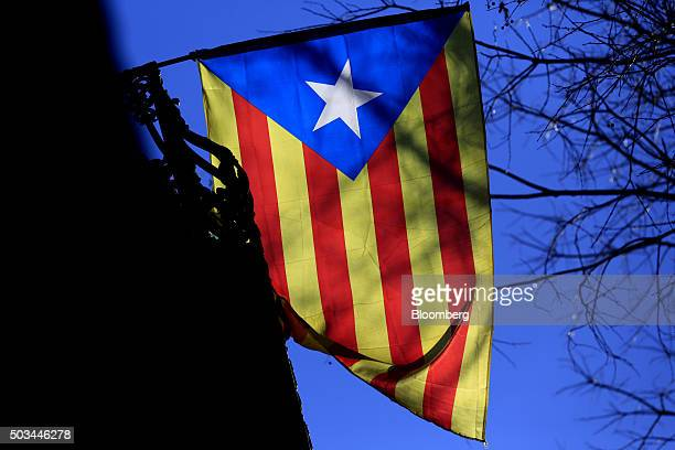 A pro Catalan independence flag flies outside a residential property in Barcelona Spain on Tuesday Jan 5 2016 Catalan Acting President Artur Mas's...