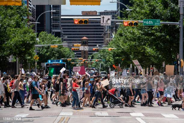 Pro choice protesters march down 6th street at a protest outside the Texas state capitol on May 29, 2021 in Austin, Texas. Thousands of protesters...