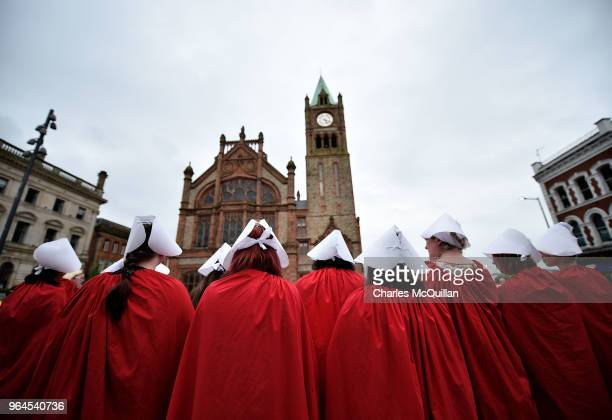 Pro Choice supporters wear handmaiden robes as the abortion rights campaign group ROSA Reproductive Rights Against Oppression Sexism and Austerity...