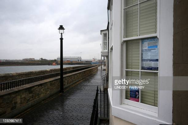 Pro Conservative Party posters are pictured in the window of a house in Hartlepool in north east England on May 3 ahead of the May 6 Hartlepool...