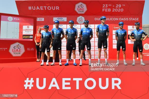 NTT Pro Cycling team of South Africa pose before the start of the first stage of the UAE Tour from the Pointe to Silicon Oasis in Dubai on February...